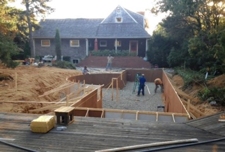 Another view of Mr. Theroux's home during pool construction.