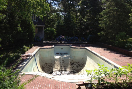Mr Theroux's cracked and leaky pool old pool in Cape Cod was broken up and trucked away.